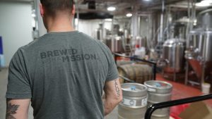Brewed with a Mission logo on tshirt