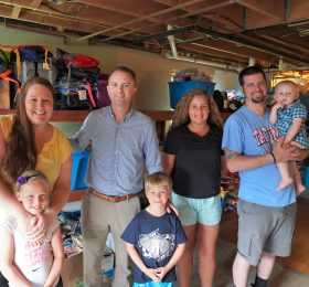 Attorney General T.J. Donovan with Elizabeth and Alex Grimes and four of their children